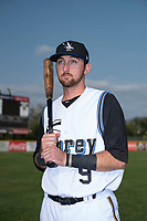 Missoula Osprey catcher Zachery Almond (9) poses for a photo prior to a Pioneer League game against the Grand Junction Rockies at Ogren Park Allegiance Field on August 21, 2018 in Missoula, Montana. The Missoula Osprey defeated the Grand Junction Rockies by a score of 2-1. (Zachary Lucy/Four Seam Images)