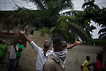 "© Remi OCHLIK/IP3 - Port au Prince on 2010 december 9 - PORT-AU-PRINCE -- Clashes and shooting were reported Thursday in Haiti's capital for a second day as demonstrators staged a march to protest what they said was election fraud in the Nov. 28 presidential elections..The protests broke out Wednesday after election officials announced Tuesday night that two candidates had made it into a runoff: Mirlande Manigat, a former first lady, and Jude CÈlestin, the candidate of current President RenÈ PrÈval's party. Out of the running was Michel ""Sweet Micky'' Martelly, who early results had shown running second. -  Martelly suppoters protest around Place St pierre."