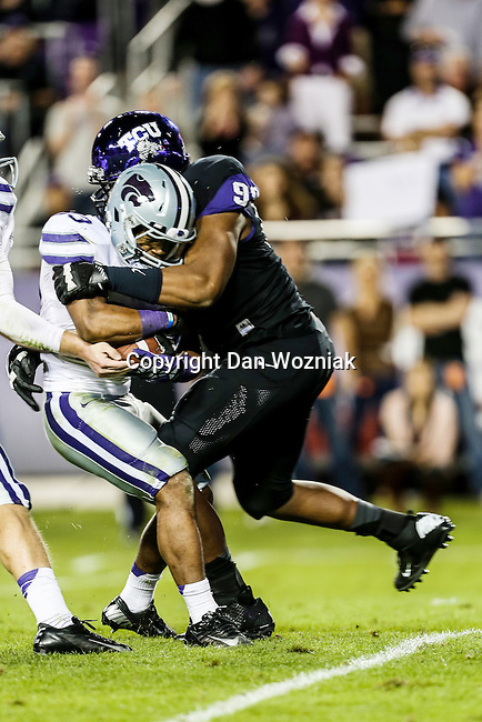 TCU Horned Frogs defensive end Michael Mosharrafa (93) tackles Kansas State Wildcats running back John Hubert (33) during the game between the Kansas State Wildcats and the TCU Horned Frogs  at the Amon G. Carter Stadium in Fort Worth, Texas. Kansas State defeats TCU 23 to 10...
