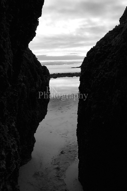 looking out of the cave that starts at the car park to the rock pools