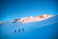Ski touring at sunrise, after leaving the Gauli Hut for the descent to Rosenlaui, during the Berner Haute Route, Switzerland