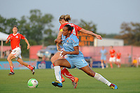 Rosana (11) of Sky Blue FC baqtles Cat Whitehill (4) of the Washington Freedom for the ball during a Women's Professional Soccer (WPS) match at Yurcak Field in Piscataway, NJ, on July 7, 2010.
