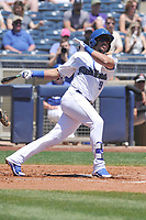 Tulsa Drillers second baseman Jose Fernandez (9) swings during a game against the Arkansas Travelers at Oneok Field on May 21, 2017 in Tulsa, Oklahoma.  The Drillers won 13-6. (Dennis Hubbard/Four Seam Images)