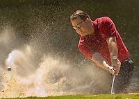 A golfer hits from a sand trap in Amelia Island, FL