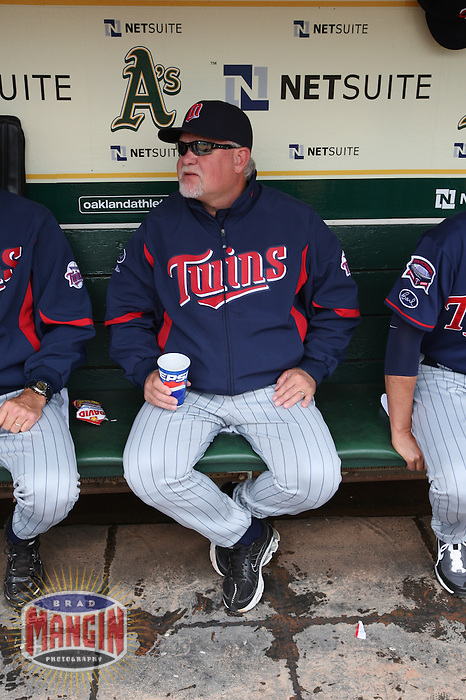 OAKLAND, CA - JULY 22:  Manager Ron Gardenhire #35 of the Minnesota Twins gets ready in the dugout before the game against the Oakland Athletics at the Oakland-Alameda County Coliseum on July 22, 2009 in Oakland, California. Photo by Brad Mangin