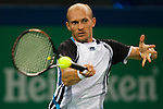 SHANGHAI, CHINA - OCTOBER 18:  Nikolay Davydenko of Russia returns a shot to Rafael Nadal of Spain on their singles final match during day eight of 2009 Shanghai ATP Masters 1000 at Qi Zhong Tennis Centre on October 18, 2009 in Shanghai China. Photo by Victor Fraile / The Power of Sport Images
