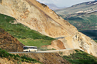 Park tour bus on the narrow winding road through Denali National Park, Alaska