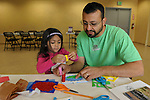 Gilbert Martinez, right, and his daughter Avani, 4, both of Sparks, create a framed wildflower during Nevada Wildflower Family Fun Day at the Nevada State Museum in Carson City Saturday April 11, 2015. Visitors to the museum were treated to loads of information, hands-on experiences and crafts.<br />