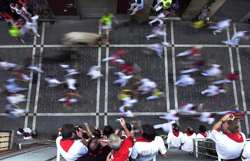 Participants run ahead of fighting bulls during a San Fermin bullrun in Pamplona. CHIPP AWARD 2008.SAN FERMIN BULL RUN IRUÑA BASQUE COUNTRY ANDER GILLENEA