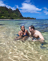 Snorkelers enjoying the day at Tunnels Beach, with Makana Mountain (a.k.a. Bali Hai) in the distance, northern Kaua'i.
