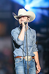 JUSTIN MOORE and band members perform a concert before the Professional Bull Riders, Iron Cowboy V bull riding event, at the AT & T stadium in Arlington, Texas.