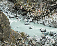 Rocky, wild and milky glacial Waiho river in Franz Josef Glacier valley, Westland Tai Poutini National Park, South Westland, West Coast, UNESCO World Heritage Area, New Zealand, NZ