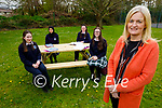 Students enjoying their new outdoor benches in the Tralee Presentation Secondary school on Friday. Front right: Chrissy Kelly (Principal). Back l to r: Shauna Moriarty, Akram Ghomeid, Emer Moriarty and Ellen Fitzmaurice.