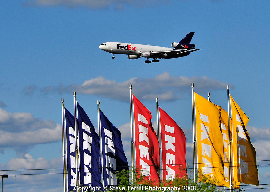 FedEx plane over IKEA flags