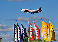 FedEx plane over IKEA flags