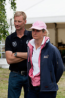 AUS-Lucinda Fredericks & ESNZ HP Coach-Erik Duvander watch Michael Jung's performance: she stayed in the lead by 1pt!!! 2012 GER-HSBC Luhmuhlen International Horse Trial - CCI****-Dressage Friday