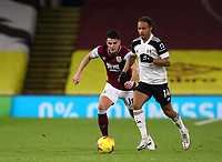 17th February 2021; Turf Moor, Burnley, Lanchashire, England; English Premier League Football, Burnley versus Fulham; Bobby Reid of Fulham runs with the ball chased by Ashley Westwood of Burnley