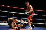 Justin Hugh stands over James Tucker after right hook floors him. Justin Hugh (Black & Red shorts) V James Tucker (Red & White shorts)Joe Calzaghe Promotions Boxing Evening .Date: Friday 20/11/2009,  .© Ian Cook IJC Photography, 07599826381, iancook@ijcphotography.co.uk,  www.ijcphotography.co.uk, .