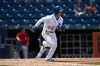 Andrew Velazquez (44) of the Durham Bulls hustles down the first base line against the Columbus Clippers at Durham Bulls Athletic Park on June 1, 2019 in Durham, North Carolina. The Bulls defeated the Clippers 11-5 in game one of a doubleheader. (Brian Westerholt/Four Seam Images)