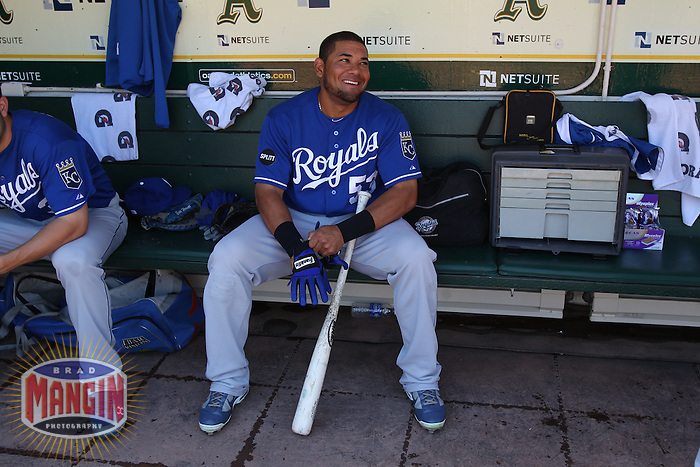 OAKLAND, CA - SEPTEMBER 5: Melky Cabrera #53 of the Kansas City Royals gets ready in the dugout before the game against the Oakland Athletics at O.co Coliseum on September 5, 2011 in Oakland, California. Photo by Brad Mangin