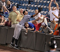 Omaha Storm Chasers first baseman Eric Hosmer #35 attempts to catch a foul ball going into the stands during a game against the Nashville Sounds at Greer Stadium on April 25, 2011 in Nashville, Tennessee.  Omaha defeated Nashville 2-1.  Photo By Mike Janes/Four Seam Images