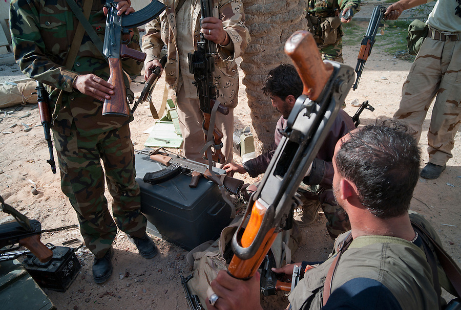 Anti-Gaddafi fighters discover a cache of weapons abandoned by Gaddafi loyalists in Sirte, Libya.