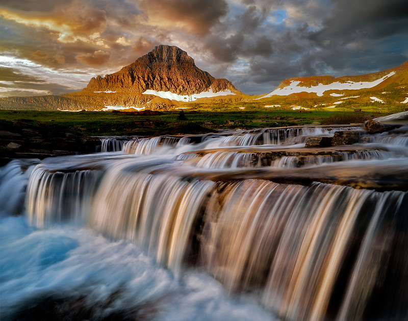 Waterfall on Reynolds Creek at Logan Pass with Mt. Reynolds and sunrise, Glacier National Park, Montana