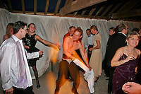 Frampton, Gloucestershire, England, 08/11/2003..The Berkeley Hunt Ball at the start of what may be the last legal hunting season in the UK, as Parliament moves to ban hunting with dogs. .Drunken partygoers perform a striptease on the dancefloor.