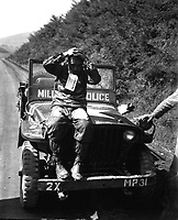 """North Korean prisoner of Marines who rolled enemy back in Naktong River fighting.  He wear a """"Prisoner of War"""" tag and was treated in accordance with United Nations' rules of international warfare.  September 4, 1950.  S. Sgt. Walter W. Frank.  (Marine Corps)<br /> NARA FILE #:  127-N-A2122<br /> WAR & CONFLICT BOOK #:  1491"""