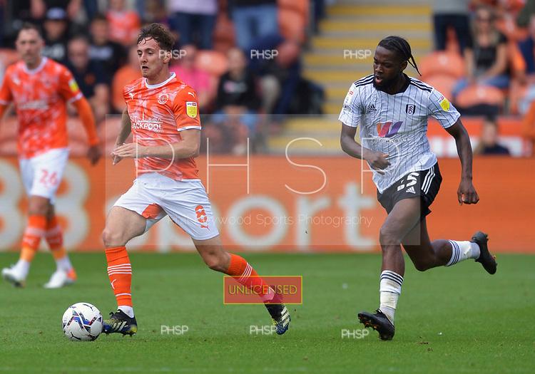 11/09/2021 Sky Bet Championship Blackpool v Fulham<br /> <br /> Ryan Wintle evades Josh Onamah