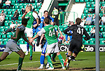 Hibs v St Johnstone.....30.04.11.No 10 Liam Craig heads the ball past keeper Jakub Divis to level the scores at 1-1.Picture by Graeme Hart..Copyright Perthshire Picture Agency.Tel: 01738 623350  Mobile: 07990 594431
