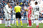 Real Madrid's (L-R) Raphael Varane, Marcelo Vieira and Carlos Henrique Casemiro and Girona FC's Cristhian Stuani during La Liga match between Real Madrid and Girona FC at Santiago Bernabeu Stadium in Madrid, Spain. February 17, 2019. (ALTERPHOTOS/A. Perez Meca)