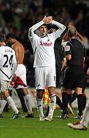 Pictured: Danny Graham of Swansea thanking home supporters at the end of the game. Saturday 19 November 2011<br /> Re: Premier League football Swansea City FC v Manchester United at the Liberty Stadium, south Wales.