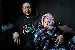 Vita Stankovic and his daughter Rada, 5, inside their meager home in an illegal Roma settlement in Belgrade, Serbia, in early 2012. In February 2012, the family received notice from city officials that they it will be evicted in March 2012 to make way for new high-rise office buildings.  In April 2012, the Serbian Orthodox family was forcibly evicted from the city center and given a metal shipping container in Makis, at the edge of Belgrade, where they could live. After several weeks, they were evicted from the shipping container because of Stankovic's repeated fights with his neighbors, and at the end of 2012 lived in an informal Roma squatter settlement in nearby Palilula. In 2009, they had been evicted from another settlement in Belgrade. The blanket protecting Rada from the cold was provided by Church World Service.