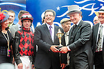Governor General David Johnston (Centre in top hat) along with the owners of Midnight Aria who won the Queen's Plate  at Woodbine Raceway in Toronto, Canada on July 07, 2013.
