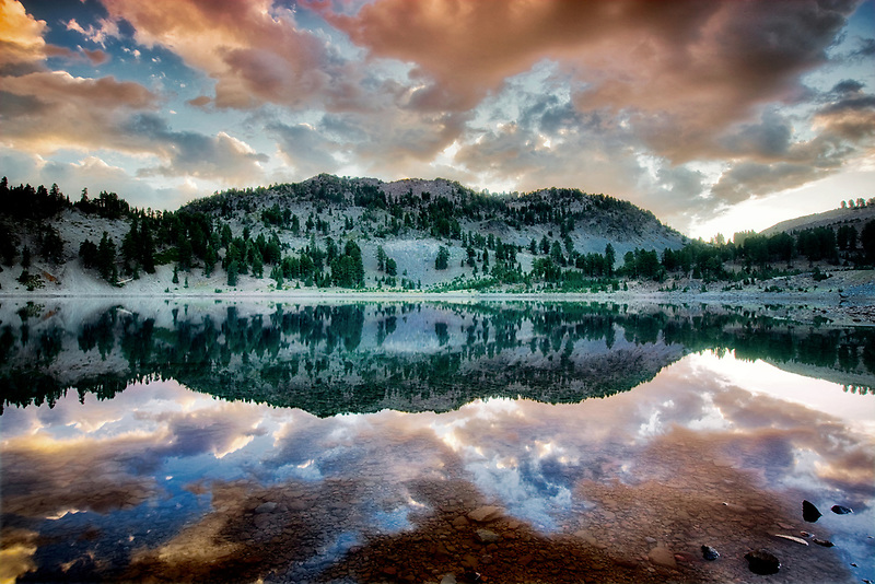 Sunrise reflected in Lake Helen. Lassen Volcanic National Park. California