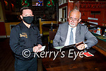 Austin Fitzgerald serving Gerard Casey at the reopening of the Brogue Inn on Thursday.