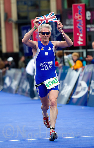 04 JUL 2010 - ATHLONE, IRL - Stuart McGowan celebrates finishing at the European Age Group Standard Distance Triathlon Championships (PHOTO (C) NIGEL FARROW)