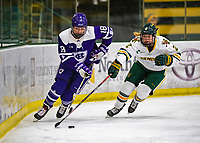 2 February 2020: Holy CrossCrusader Forward Rachel Moore, a Senior from Falmouth, MA, and University of Vermont Catamount Defender Sini Karjalainen, a Sophomore from Posio, Finland, battle for possession during first period NCAA Women's Hockey action at Gutterson Fieldhouse in Burlington, Vermont. The Lady Cats rallied in the 3rd period to tie the Crusaders 2-2 in NCAA Women's Hockey East play. Mandatory Credit: Ed Wolfstein Photo *** RAW (NEF) Image File Available ***
