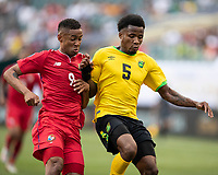 PHILADELPHIA, PA - JUNE 30: Elvis Powell #5 and Gabriel Torres #9 contest the ball during a game between Panama and Jamaica at Lincoln Financial Field on June 30, 2019 in Philadelphia, Pennsylvania.