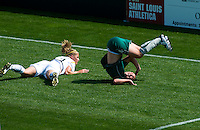 St Louis Athletica forward Melissa Tancredi (14) flips on the ground after running into Los Angeles Sol defender Allison Falk (3) during a WPS match at Hermann Stadium, in St. Louis, MO, April 25 2009.  Athletica and Sol tied the match.