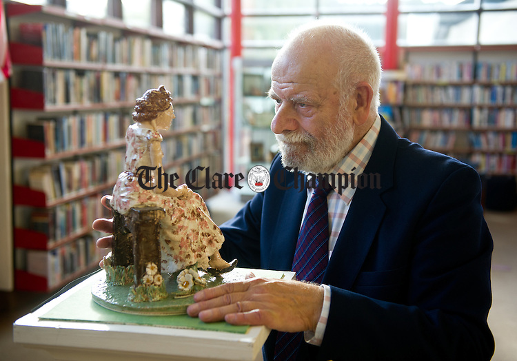 Artist Colin Thickbroom, of Shannon, originally from Yorkshire, with a sculpture he made of his late wife Joyce Mary who passed away, while suffering from Alzheimer's 18th months ago, at the opening of his exhibition of paintings and sculptures in the Sean Lemass Library, Shannon. The proceeds are for the Alzheimer's Association of Ireland. Phpotograph by John Kelly.