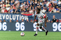 FOXBOROUGH, MA - JULY 7: Ayo Akinola #20 of Toronto FC dribbles during a game between Toronto FC and New England Revolution at Gillette Stadium on July 7, 2021 in Foxborough, Massachusetts.