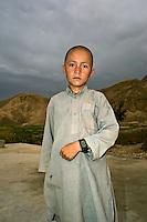 A boy proudly displays his digital wristwatch.