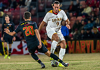 COLLEGE PARK, MD - NOVEMBER 21: Justin Harris #20 of Maryland tackles Esad Mackic #9 of Iona during a game between Iona College and University of Maryland at Ludwig Field on November 21, 2019 in College Park, Maryland.