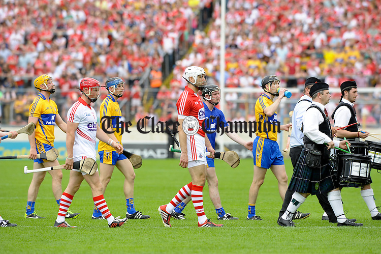 The Clare and Cork teams march behind the band before the Senior hurling championship semi-final at Thurles. Photograph by John Kelly.