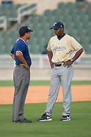 Lake County Captains manager Aaron Holbert #13 discusses a call with base umpire Erik Hill at Fieldcrest Cannon Stadium May 3, 2009 in Kannapolis, North Carolina. (Photo by Brian Westerholt / Four Seam Images)