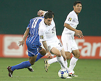 Santino Quaranta #20 of the USA pulls away from Melvin Valladares #18 of Honduras during a CONCACAF Gold Cup match at RFK Stadium on July 8 2009 in Washington D.C. USA won 2-0.