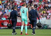 Adam Webster of Brighton & Hove Albion leaves the field after suffering an injury during Brentford vs Brighton & Hove Albion, Premier League Football at the Brentford Community Stadium on 11th September 2021