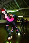 February 19, 2008; Santa Cruz, CA, USA; A female athlete skates during Santa Cruz Rollergirls practice in Santa Cruz, CA. Photo by: Phillip Carter